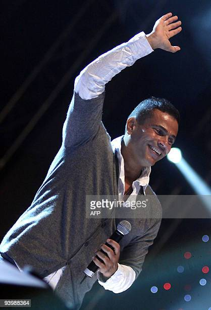 Egyptian singer Amr Diab performs during a concert at Future University in Cairo late on December 4 2009 AFP PHOTO/STR