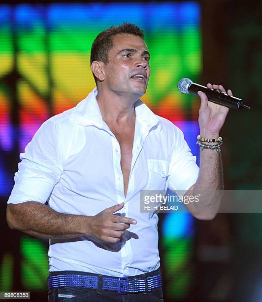 Egyptian singer Amr Diab performs during the 45th edition of the International Carthage festival late on August 14 at the Roman theatre in Carthage...