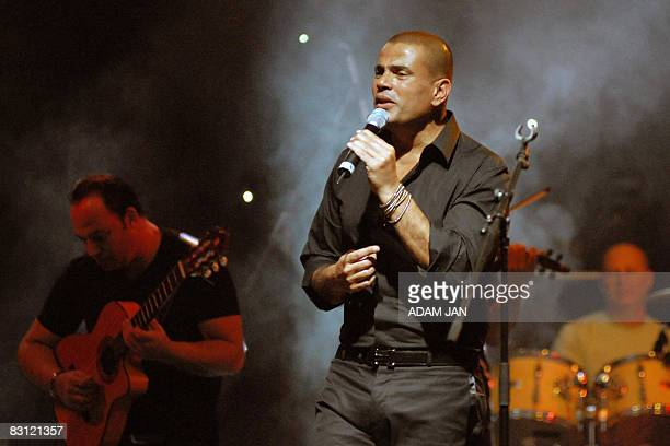 Egyptian singer Amr Diab performs live in concert in Bahrain's capital Manama on October 3 as part of the extended Eid alFitr celebrations AFP...