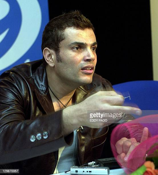 Egyptian singer Amro Diab gestures during a press conference in Dubai 15 February 2003 AFP PHOTO/Eddy PADO