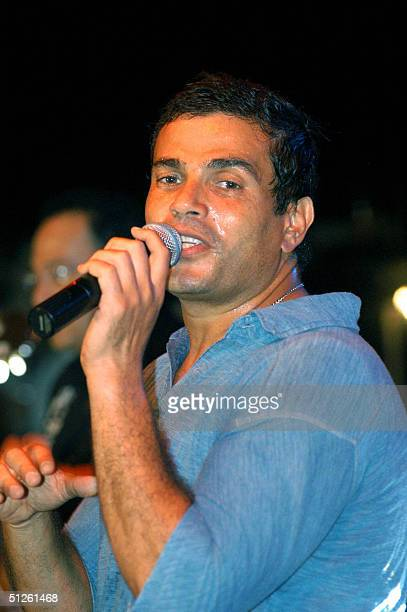 Egyptian Singer Amro Diab performs at the closing ceremony of a beach football tournament late 03 September 2004 in the northwestern port city of...