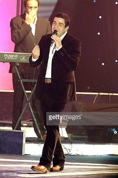 Egyptian singer Amro Diab performs in Kuwait City late 09 February 2005 during the emirate's annual shopping festival which includes daily...