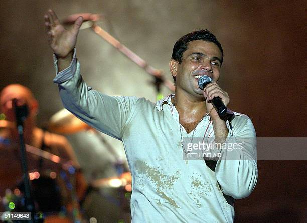 Egyptian singer Amro Diab performs late 06 August 2004 during the Carthage international festival in the Roman theatre AFP PHOTO/FETHI BELAID