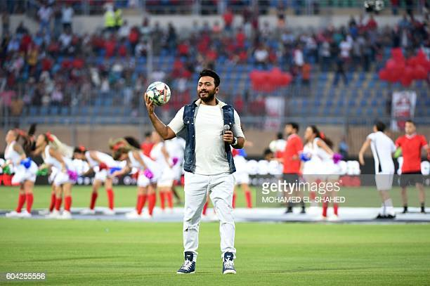 Egyptian singer and actor Tamer Hosny sings before the Arabian Gulf Super Cup match between Emirati teams AlJazira and AlAhli at the 30 June Stadium...