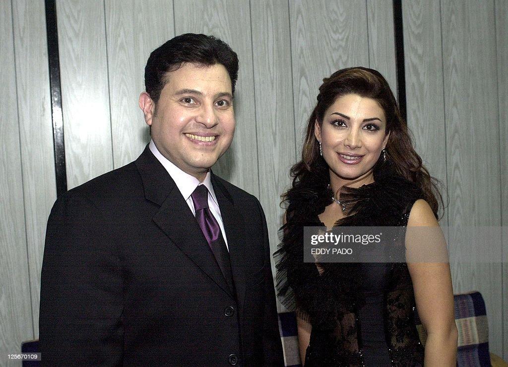 Egyptian singer Hani Shaker poses with Lebanese singer Aline Khalaf