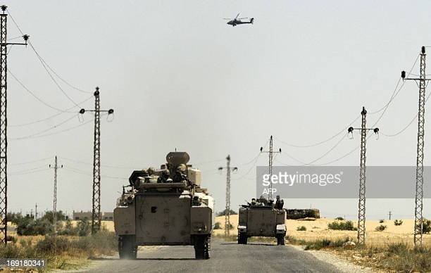 Egyptian soldiers and a military helicopter are deployed in the area of the Rafah Crossing border between Egypt and the Gaza Strip on May 21 2013 as...