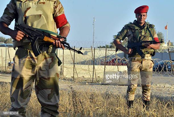 Egyptian soldiers are deployed in the area of the Rafah Crossing border between Egypt and the Gaza Strip on May 21 2013 as Egypt intensified efforts...