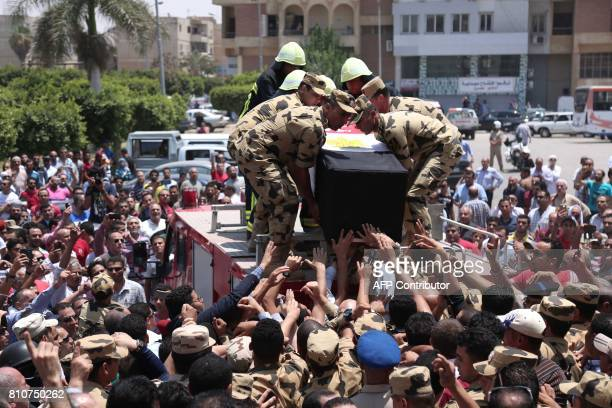 Egyptian soldiers carry the coffin of a soldier who was killed a day earlier in the restive Sinai Peninsula in an attack by the Islamic State group...