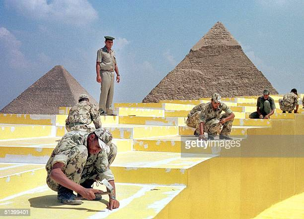 Egyptian soldiers construct a stage 16 September 1999 for another lavish edition of the opera Aida beneath Egypt's Giza Pyramids set 1217 October...