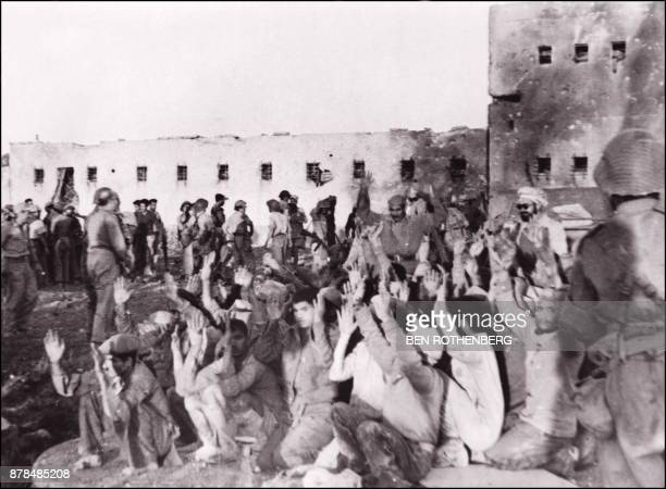 Egyptian soldiers of allied Arab forces surrender 18 November 1948 in Iraq Suweidan fort to Israeli soldiers during Israeli offensive in Negev...