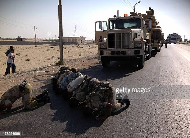 Egyptian soldiers pray as they are deployed in the northern Sinai town of AlArish on July 16 2013 With an insurgency threatening its sensitive border...