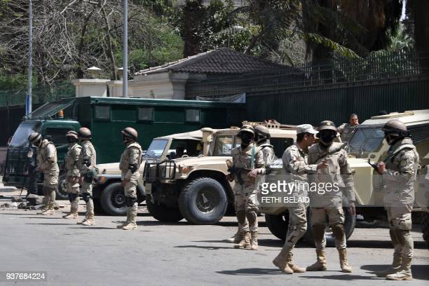 Egyptian soldiers stand guard Cairo university on March 25 2018 in central Cairo ahead of the March 2628 presidential election Egypt's military said...