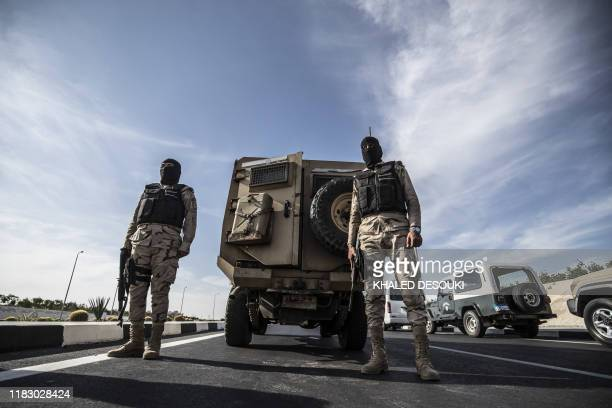 Egyptian soldiers stand guard during an organised tour for diplomats to mark the 150th anniversary of the inauguration of the Suez Canal in the...