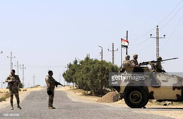 Egyptian soldiers stand guard in the area of the Rafah Crossing border between Egypt and the Gaza Strip on May 21 2013 as Egypt intensified efforts...