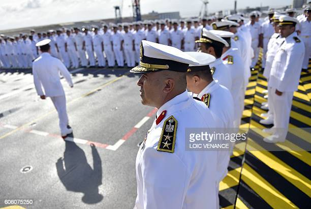 Egyptian soldiers stand on the deck of the BPC Anwar el Sadate military cruise ship during the flag ceremony on September 16 2016 in SaintNazaire...