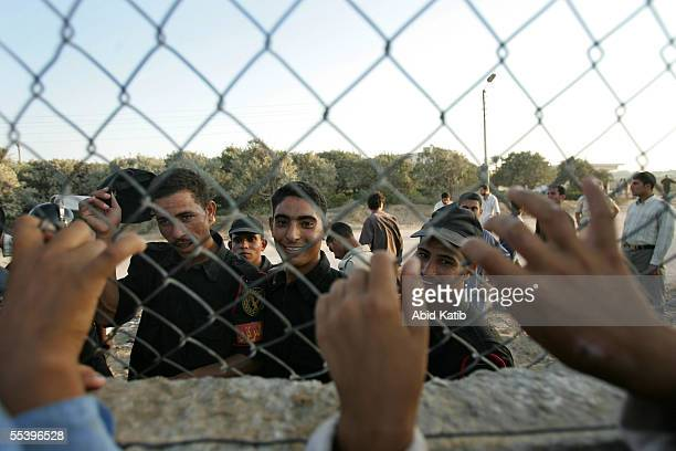 Egyptian soldiers talk to Palestinians through the fence of the now EgyptianPalestinian controlled border September 13 2005 in Rafah southern Gaza...