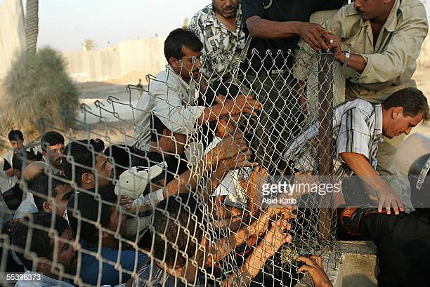 Egyptian soldiers try to control Palestinians while they try to cross the now EgyptianPalestinian controlled border September 13 2005 near Rafah Gaza...