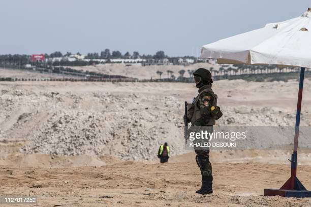 Egyptian Special Forces stand guard outside the International Congress Centre on February 24 ahead of first joint European Union and Arab League...
