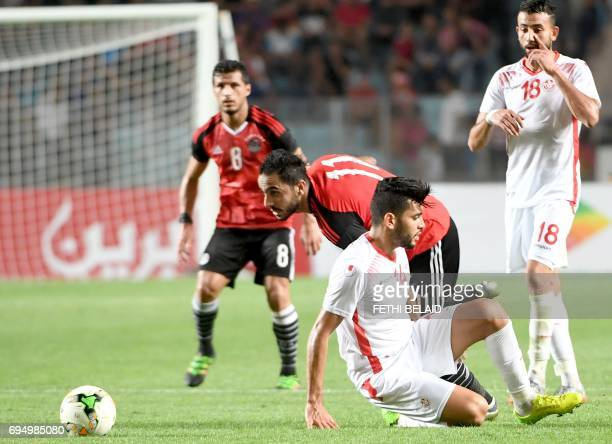 Egyptian striker Mohmoud Abdelmonem Soliman vies with Tunisian forward Amine Ben Amor during their African Cup of Nations CAN 2019 preliminary stage...