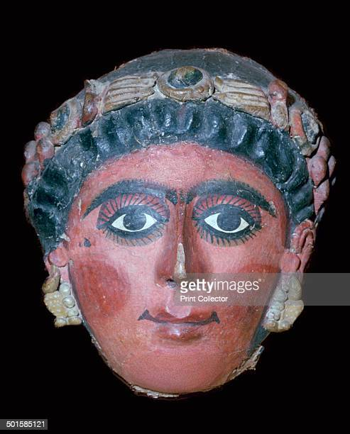 Egyptian stucco painted funerary mask of a woman 2nd century BC