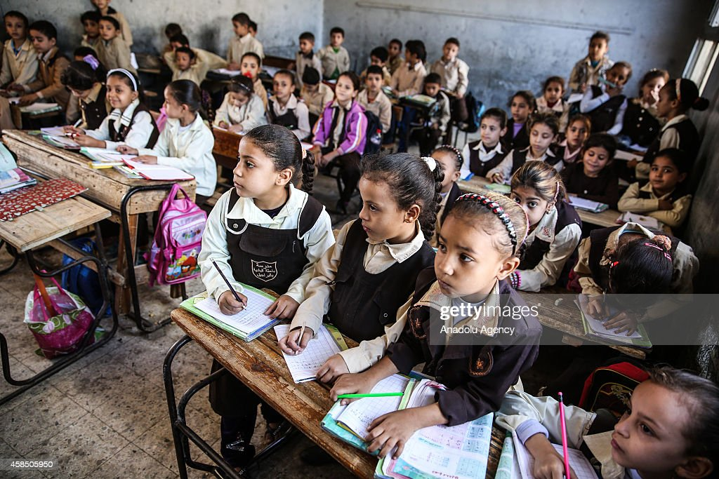 Egyptian students are seen during a lesson at the class of a primary school, where nearly 2 thousand students get education, in Baragil neighborhood of Giza, Egypt on October 30, 2014. Head master of the school complains about the crowded classroom sizes, reaching up to 70, lack of the desks and other impossibilities. Formal education, at every level, is provided freely at state schools in Egypt. Downswing due to the ongoing 4-year unrest, Egypt tries to overcome many difficulties and uncertainties.
