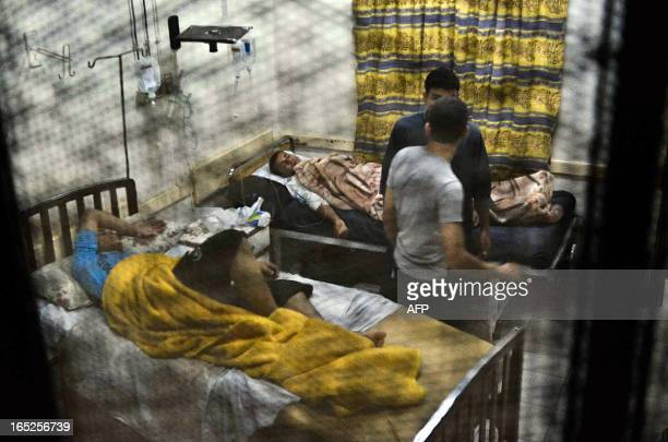 Egyptian students from the alAzhar University rest in a hospital in Cairo late on April 1 after hundreds suffered food poisoning at a dormitory...
