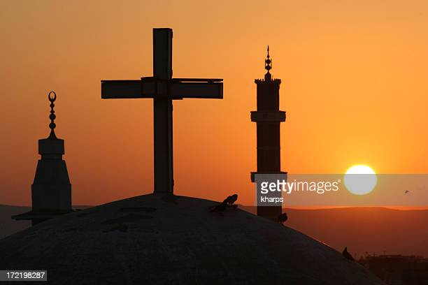 egyptian sunrise with cross and crescents - christendom stockfoto's en -beelden