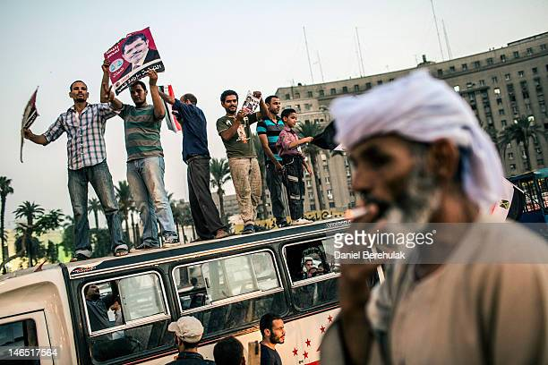 Egyptian supporters celebrate a premature victory for their presidential candidate Mohamed Morsi in Tahrir Square on June 18 2012 in Cairo Egypt...