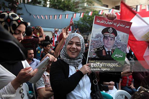 Egyptian supporters of AbdelFatah alSisi in Gaza celebrate after Egypt's electoral commission declared Sisi as the new president of Egypt on June 03...