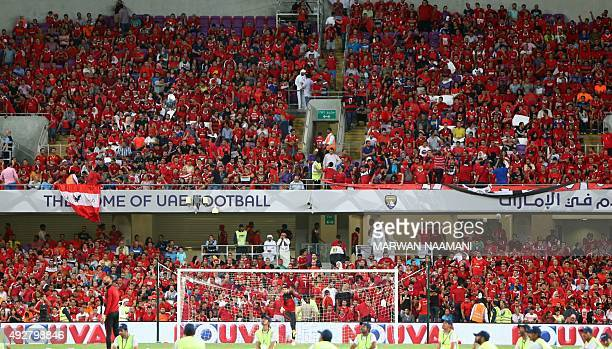 Egyptian supporters of AlAhly football team wait for the start of the Egypt super cup football match between Egypt's AlAhly SC and Zamalek October 15...