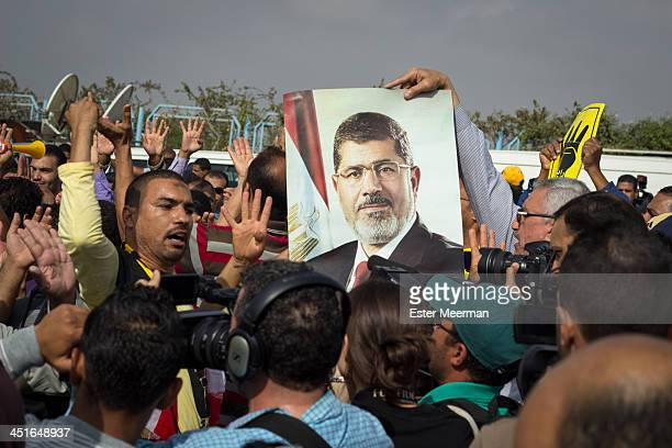 Egyptian supporters of ousted president Mohamed Morsi and of the Muslim Brotherhood protest outside the Police Academy in New Cairo on the first day...