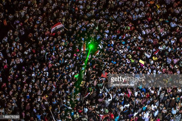 Egyptian supporters of the Muslim Brotherhood celebrate a premature victory for their presidential candidate Mohamed Morsi in Tahrir Square on June...