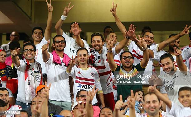 Egyptian supporters of Zamalek football team wait for the start of the Egypt super cup football match between Egypt's AlAhly SC and Zamalek October...