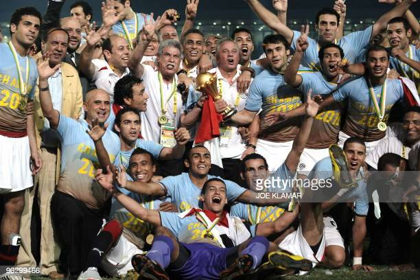 Egyptian team celebrates with CAF trophy during award ceremony after Egypt won over Ghana 10 during African Cup of Nations football championships...