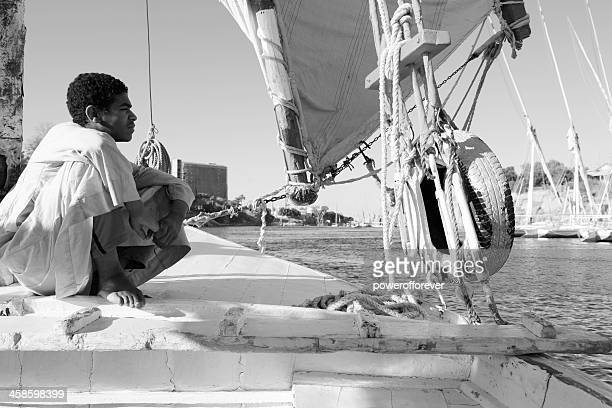 Egyptian Teenager Working on the Family Dhow