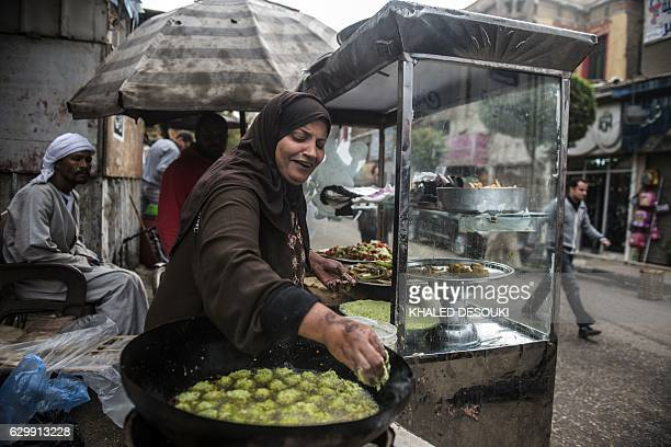 Egyptian Um Adham cooks Falafel in a street in the capital Cairo on December 15 2016 / AFP / KHALED DESOUKI