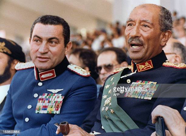Egyptian vice President Gen Hosni Mubarak and late President Anwar Sadat both dressed in military honour uniforms attend a military parade 06 October...