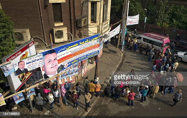 Egyptian voters snake around a block as they queue to cast their ballots outside a polling station in the Cairo neighbourhood of Zamalek on November...
