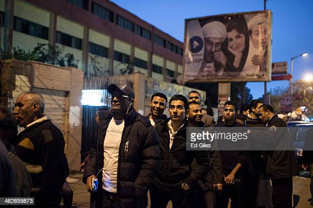 Egyptian voters stand in line at a polling booth in the district of Mohandessin on January 14 2014 in Cairo Egypt Some clashes between protesters and...
