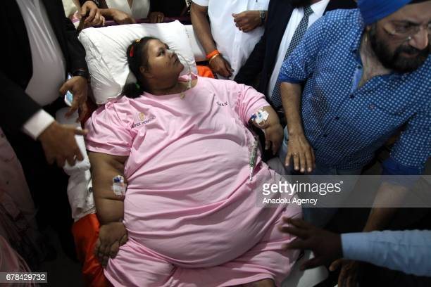 Egyptian woman Emam Ahmed who was undergoing weight-loss surgery at Mumbais Saifee Hospital is carried on a stretcher towards an ambulance on her way...