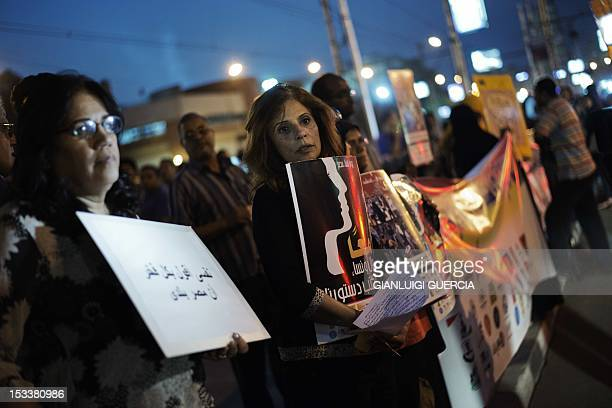 Egyptian women and activists demonstrate in front of the presidential palace in Cairo on October 4 to support women rights in the constitution and...