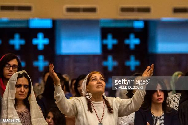 Egyptian women attend an Easter mass led by Egypt's Coptic Christian Pope Tawadros II at the Saint Mark's Coptic Cathedral in Cairo's alAbbassiya...