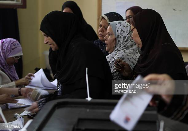 Egyptian women gather at a polling station in Cairo to cast their votes on June 16 2012 in a divisive presidential runoff pitting ousted strongman...