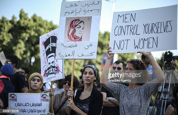 Egyptian women hold signs during a protest against sexual harassment in Cairo Egypt on June 14 2014