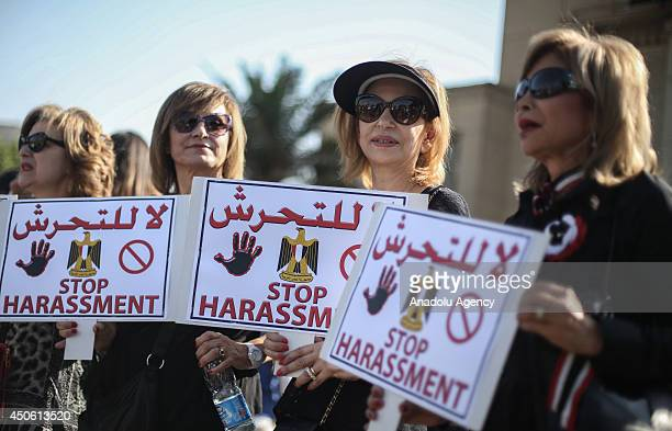 Egyptian women hold signs during a protest against sexual harassment in Cairo, Egypt on June 14, 2014.