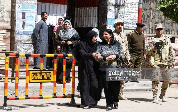 Egyptian women leave a polling station casting their votes at a polling station in the Nile Delta City of Tanta 120 kilometres north of Cairo on...
