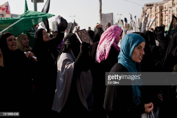 Egyptian women take part in a protest following midday prayers in Tahrir Square on September 14 2012 in Cairo Egypt Over two hundred people have been...