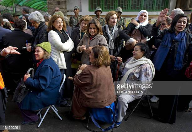 Egyptian women wait to cast their votes at a polling station in the Zamalek neighbourhood of Cairo on November 28 2011 Egyptians began voting in the...