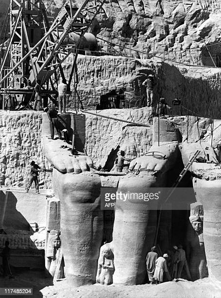 Egyptian workers are dismantling Ramses II statues to be moved to the new site of the twin temples of Abu Simbel 26 January 1966 The Abu Simbel...
