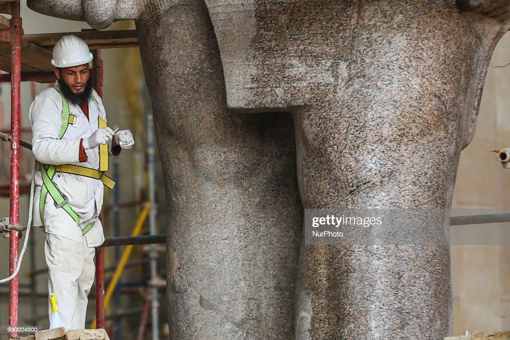 Granite statue of Ramses II restored in Giza : News Photo